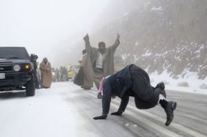 People-play-with-snow-after-a-heavy-snowstorm-in-the-desert-near-Tabuk-1500-km-932-miles-from-Riyadh.